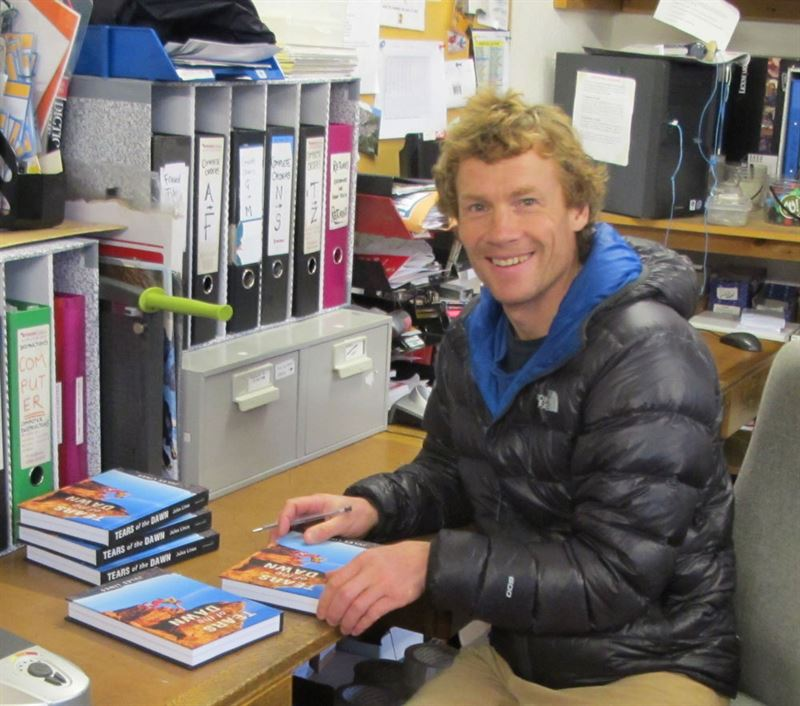 Julian Lines signing copies of the first edition at Needle Sports in 2013